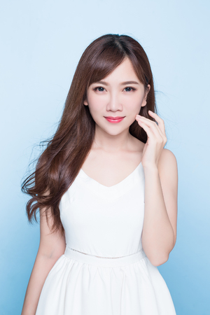 beauty woman look you on the blue background 写真素材