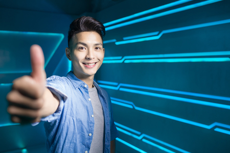 project: man smile happily and thumb up on the technology background