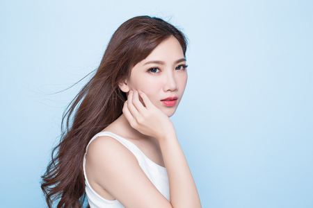 beauty woman look you on the blue background Stock Photo