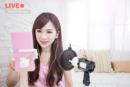 screen: beauty woman smile in live at home Stock Photo