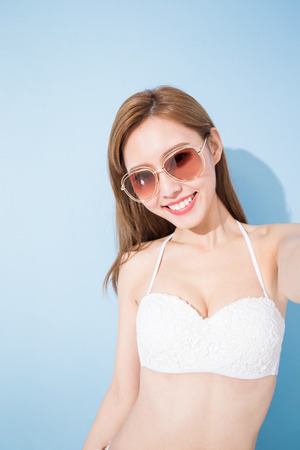 whiten: woman selfie happily on the blue background Stock Photo