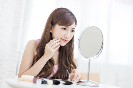beauty woman look mirror in the room Stock Photo