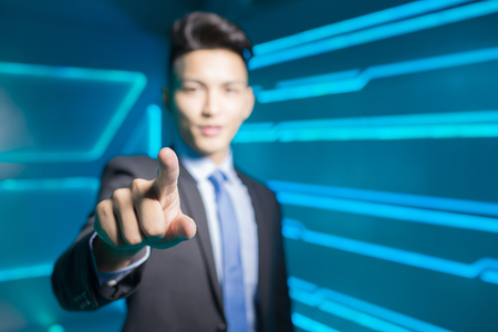 project: business man touch something on technology background