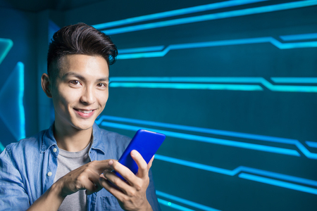 project: man use phone on the technology background