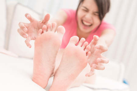 woman with athlete foot in the room