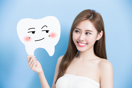 whiten: woman take cute tooth billboard on the blue background