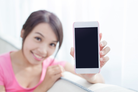 woman show smart phone to you in the room photo