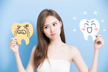 bacteria cartoon: woman take health and decay tooth billboard on the blue background