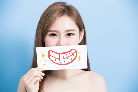 woman take cute tooth billboard on the blue background