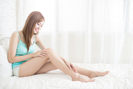 beauty woman smile happily and sit on the bed