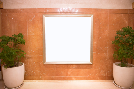 empty: frame hangs on wall in the street Stock Photo