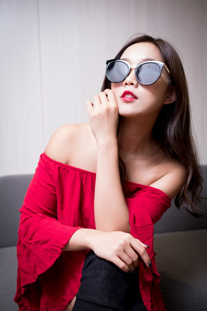 beauty fashion woman sit on the sofa