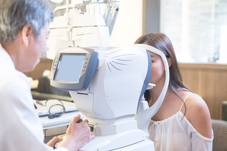 beauty woman with optometristn in the store Stock Photo