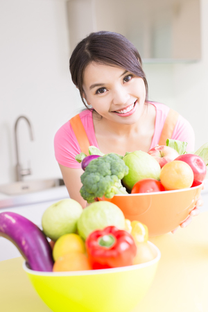beauty housewife smile happily in the kitchen photo