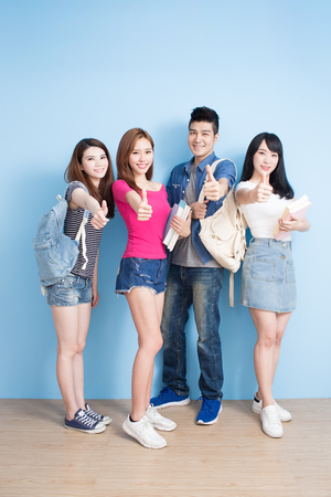 happy group student show thumb up on the blue background Stock Photo