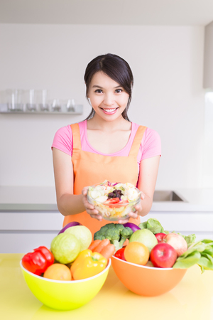 beauty housewife hold salad in the kitchen photo