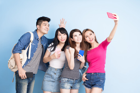 technology: student selfie happily on the blue background Stock Photo