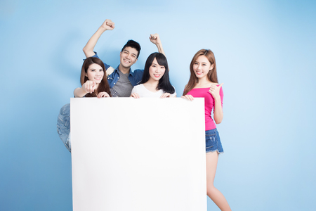 happy group student take billboard on the blue background Stock Photo