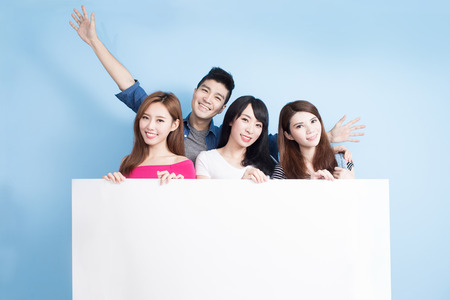 happy group student take billboard on the blue background photo