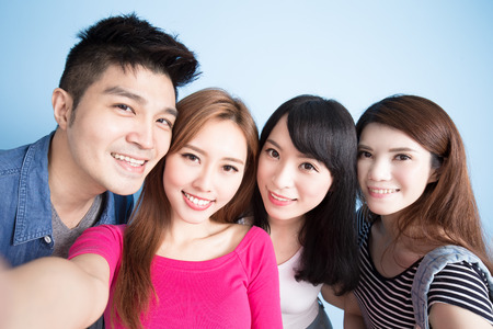 student selfie happily on the blue background photo