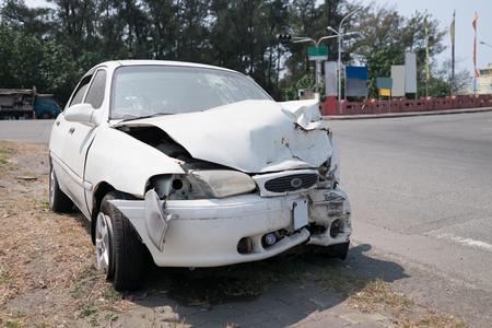 auto repair: close up of crash car in the road