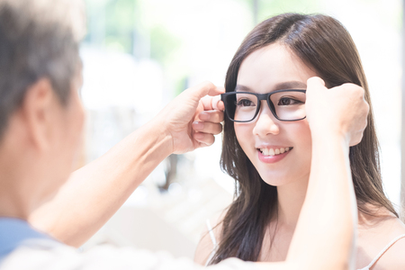 beauty woman smile and wear eyeglasses with optometrist