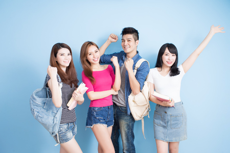 happy group student feel free on the blue background