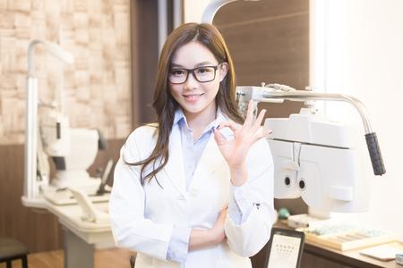 beauty woman optometrist smile happily and show ok to you