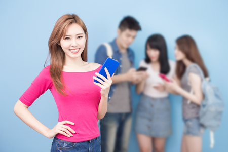 student use phone on the blue background photo