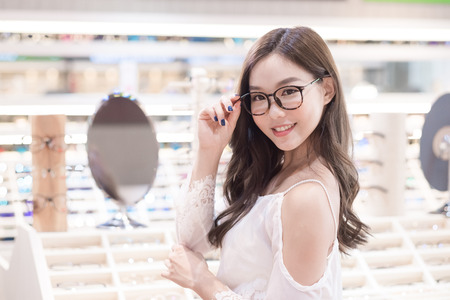 beauty woman wear eyeglasses in the store