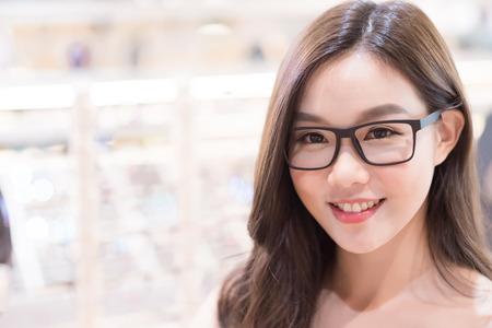 beauty woman wear eyeglasses in the store