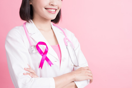 doctor with breast cancer prevent concept on the pink background