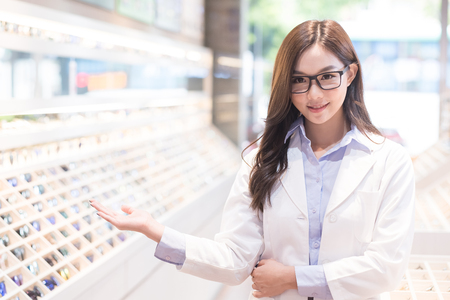beauty woman optometrist smile happily and show something