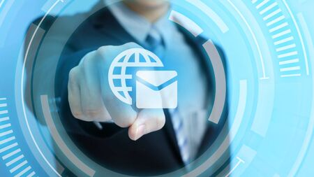 business man touch email icon on the blue background 版權商用圖片