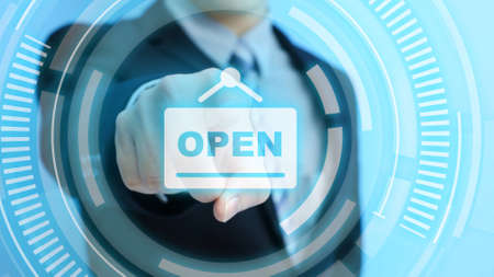businessman touch open icon on the blue background