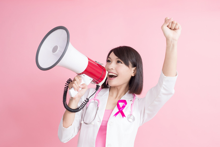 woman woman doctor take microphone and feel excited with chest health concept on pink bakcground