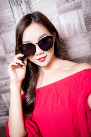 sexy asian woman: beauty fashion woman selfie on the wall