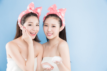 salon background: two beauty woman with make up concept on the blue background