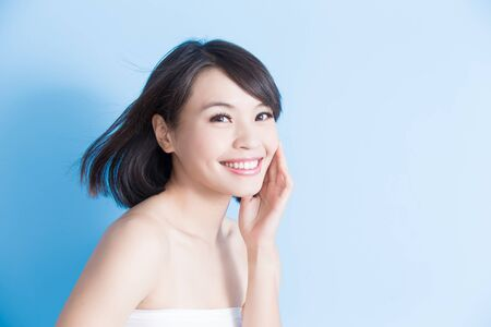 salon background: beauty woman smile happily on the blue background