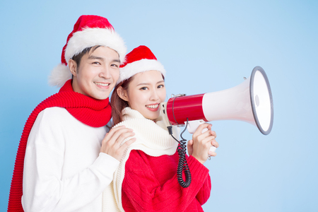 Couple smile and take microphone with merry Christmas 版權商用圖片