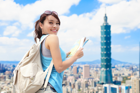 Happy travel woman take map and look to you in taipei