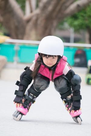 close up of cute girl play roller skating