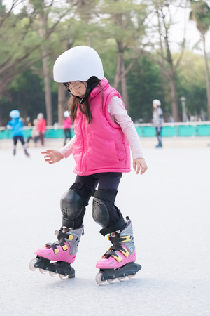 close up of cute girl play roller skating