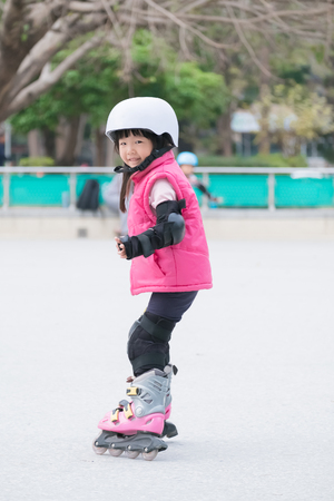 skate park: close up of cute girl play roller skating
