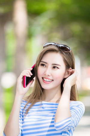 woman talk on phone in the park