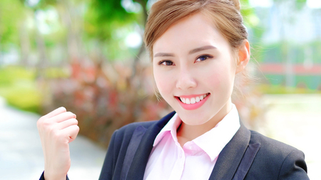 beauty business woman smile to you and show fist Stock Photo