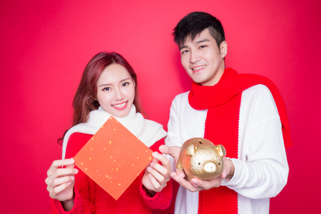 couple show couplet and piggy on the red background