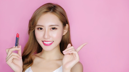 beauty makeup woman smile to you with lipstick and show something Stock Photo - 90768569