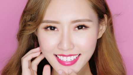 beauty makeup woman smile to you on the pink background