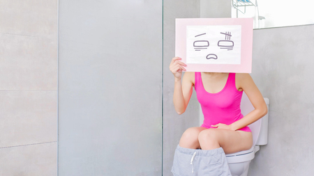 woman take confuse billboard with constipation in the toilet